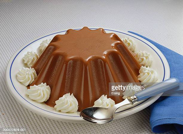 Chocolate pudding with blobs of cream