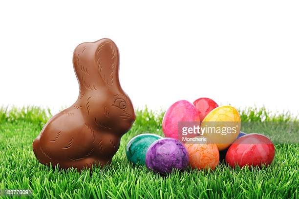 Chocolate rabbit with colorful easter eggs