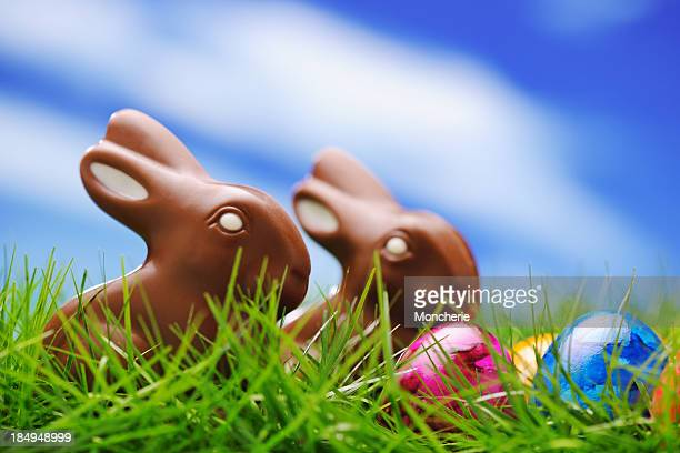 Chocolate rabbits with colorful easter eggs