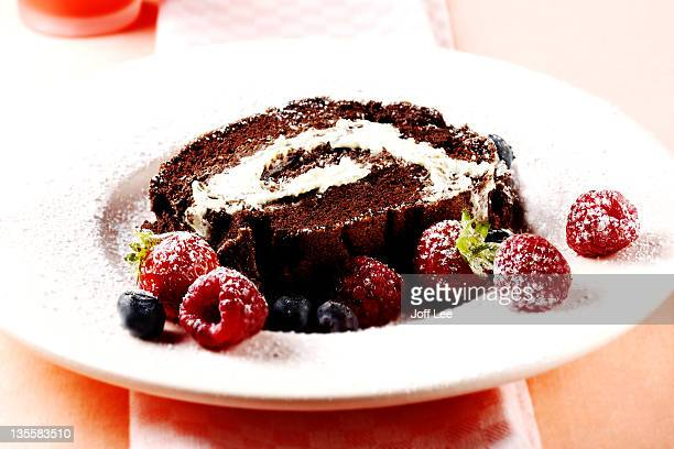 Chocolate roulade with raspberries and blueberries