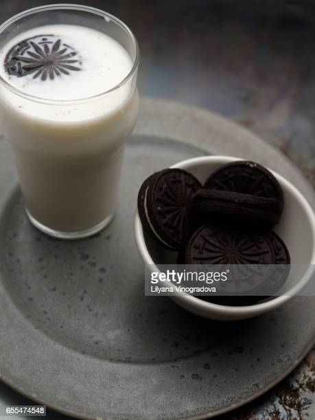 Chocolate sandwich cookies with milk