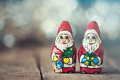 Chocolate Santa Claus with a bag on a old wooden background