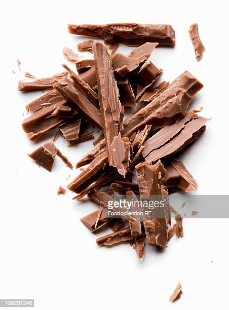 Chocolate shavings on white background, close-up