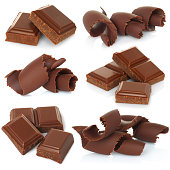 Chocolate shavings with blocks set on white background close-up