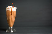 Chocolate smoothie with bananas on the dark wooden background