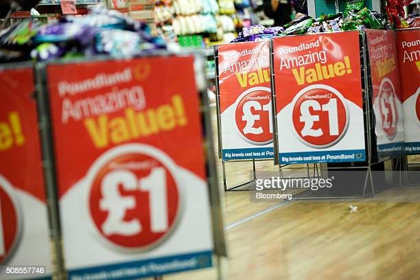 Chocolate snacks sit in wire basket bins with a one pound sterling sign attached at Poundland Group Plc store in Leigh UK on Thursday Feb 4 2016 UK...