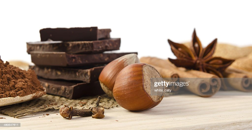 chocolate, spices and nuts - sweet food : Stock Photo