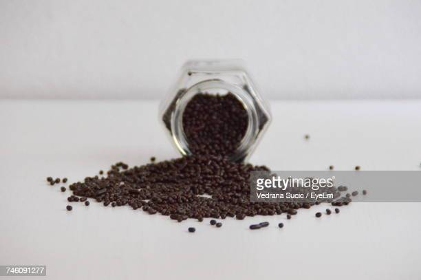 Chocolate Sprinkles In Jar On White Table