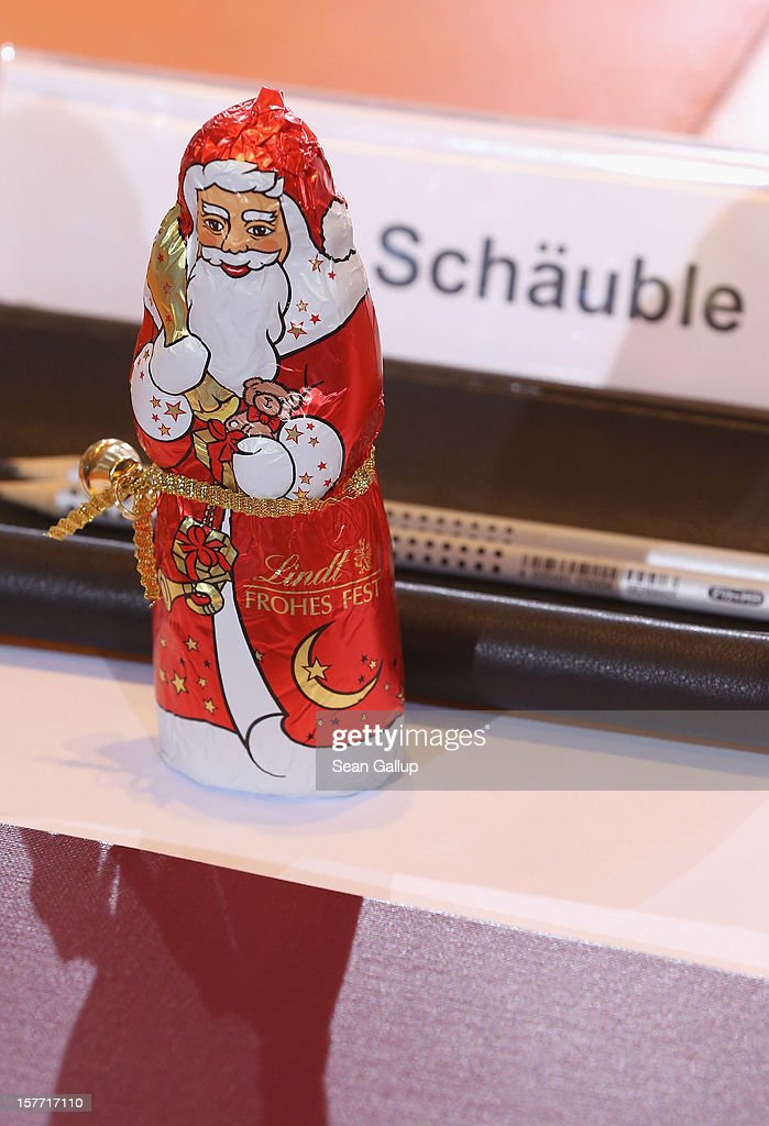 A chocolate St. Nicholas stands at the place of German Finance Minister Wolfgang Schaeuble prior to the weekly German government cabinet meeting on December 6, 2012 in Berlin, Germany. Schaeuble has been among the more conservative voices in the current policy debates surrounding the Eurozone debt crisis.