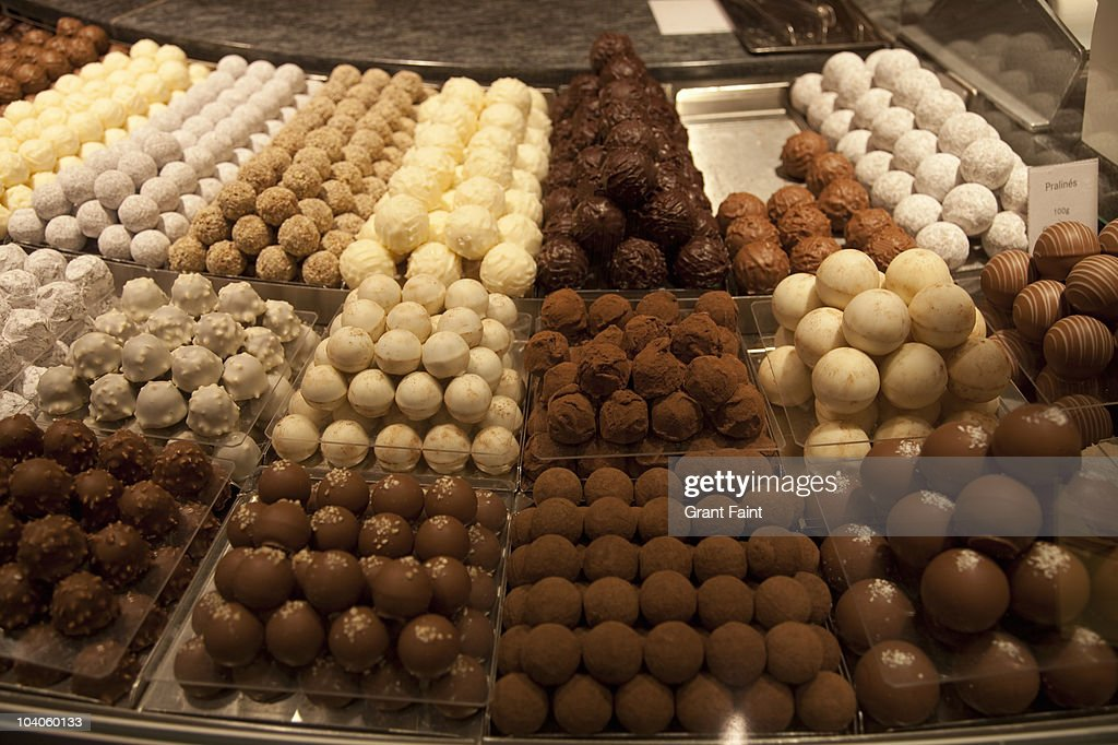 chocolate truffles in shop display case.