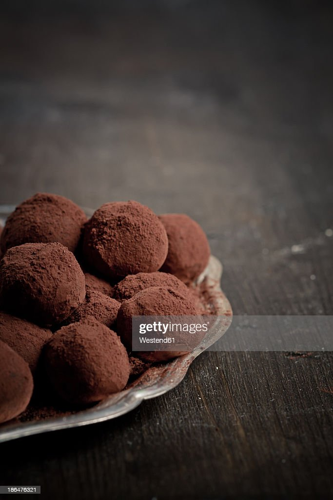 Chocolate truffles on silver plate, close up