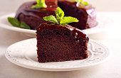 Chocolate vegan cake with chocolate ganache on top, sliced