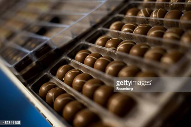 Chocolate wait to be sorted into boxes at the Jacques Torres Chocolate factory in the Brooklyn borough of New York US on Thursday Feb 6 2014 There...
