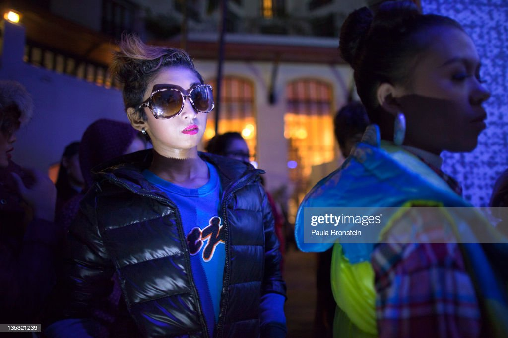 Chocolate, 16, (center) waits with other fashion models backstage for their signal to go on the boardwalk during a show featuring OPT jeans December 8, 2011 in Yangon, Myanmar. The pace of change in Myanmar brought U.S Secretary of State Hillary Clinton to the country where she discussed further paths to reform and crucial talks with both Aung San Suu Kyi and the highest levels of the Burmese government. For many years Myanmar has suffered from economic stagnation, political repression and international isolation. In March the army handed power to a civilian government after almost five decades of the military regime's strong arm rule. The handover took place after a controlled election under a new constitution that preserved much of the military clout. Internet has been loosened up as previously inaccessible foreign news and opposition websites have been unblocked.