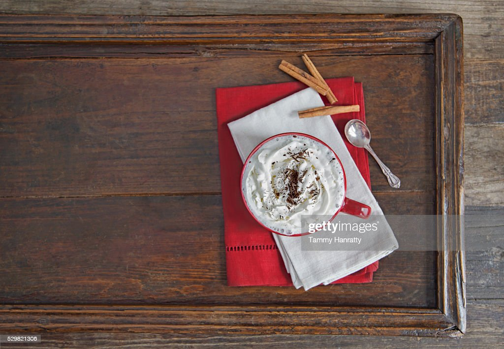 Chocolate with cream on wooden tray : Stock Photo