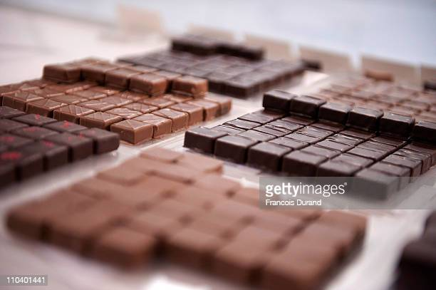 Chocolates are displayed at 'Un Dimanche A Paris' store on March 17 2011 in Paris France 'Un Dimanche A Paris' Chocolate Concept Store founded by...