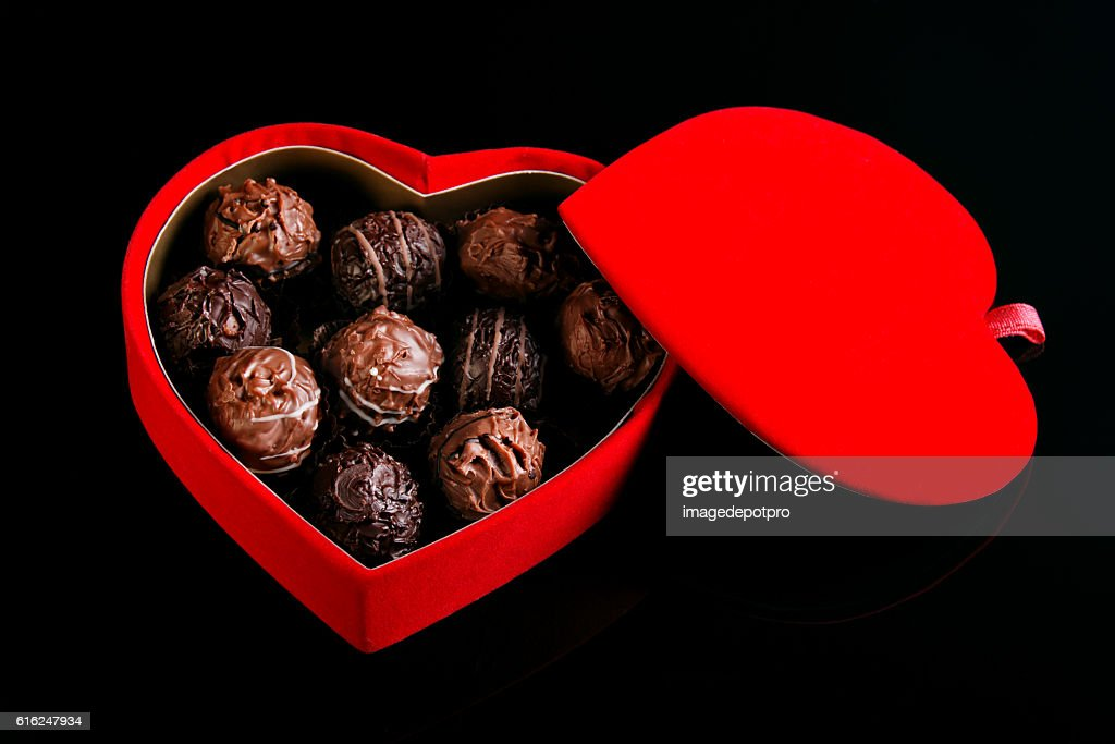 chocolates in heart shaped box : Stock Photo