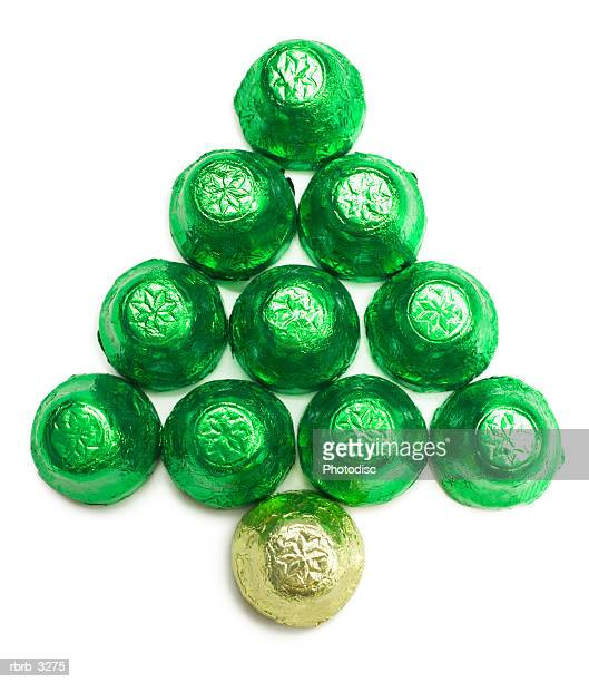Chocolates wrapped in colored foil arranged in the shape of a Christmas tree