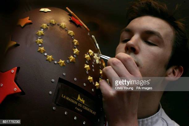 Chocolatier Christophe Laurens makes a few final adjustments to a 50000 diamondencrusted Easter egg at La Maison du Chocolat in Piccadilly central...