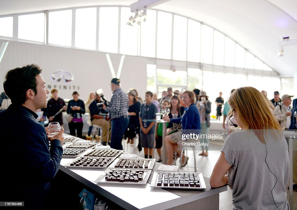 Chocolatier Jonathan Grahm (L) and master sommelier Andrea Robinson speak during day 4 of Moments of Inspiration presented by Infiniti in partnership with Hearst Magazines on August 18, 2013 in Pebble Beach, California.