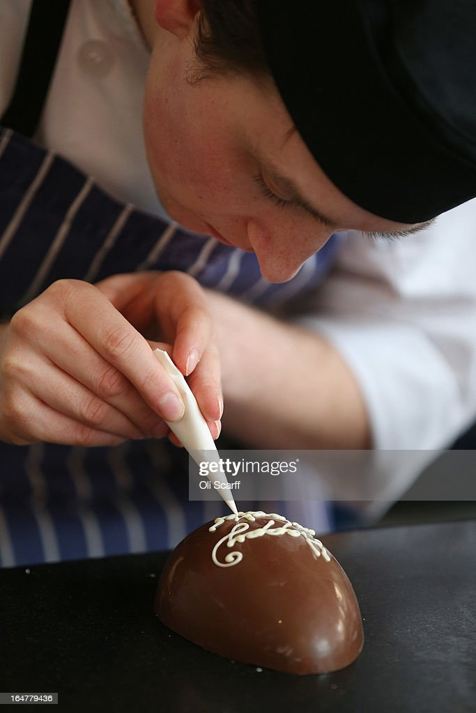 Chocolatier Stephen Glenister creates handmade Easter eggs in the 'Melt' chocolate shop in Notting Hill on March 28, 2013 in London, England. Easter represents the busiest time of year for the luxury chocolate retailer 'Melt' who, in addition to their regular customised Easter eggs, also make a range of large themed eggs with a limited edition of 5.