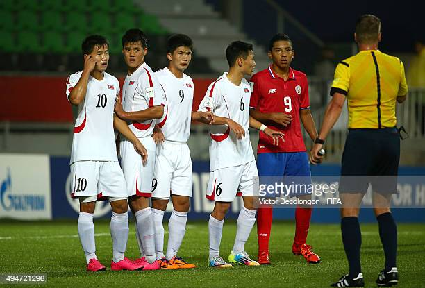 Choe Song Hyok Yon Jun Hyok Han Kwang Song and Kim Ye Bom of Korea DPR and Andy Reyes of Costa Rica line up in front of the Korea DPR net prior to a...