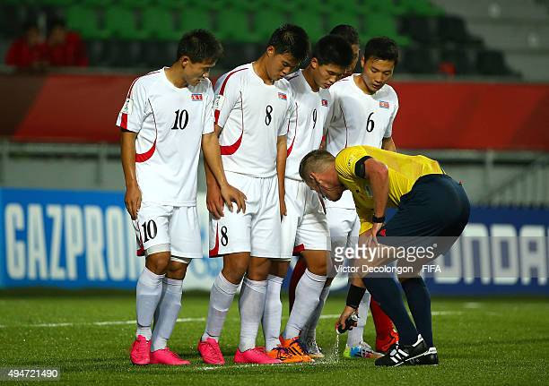 Choe Song Hyok Yon Jun Hyok Han Kwang Song and Kim Ye Bom of Korea DPR watch as FIFA referee Danny Makkelie draws a line prior to a Costa Rica direct...
