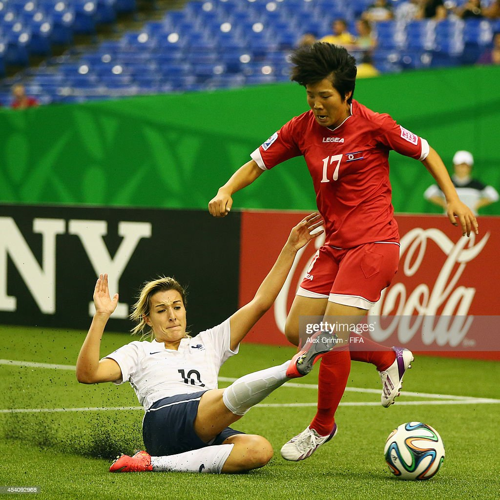 Choe Un Hwa of Korea DPR is challenged by Claire Lavogez of France during the FIFA U-20 Women's World Cup Canada 2014 3rd place match between Korea DPR and France at Olympic Stadium on August 24, 2014 in Montreal, Canada.