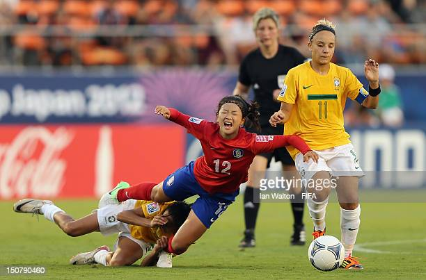 Choe Yuri of Korea Republic competes for the ball with Thais Guedes of Brazil during the FIFA U20 Women's World Cup Japan 2012 Group B match between...
