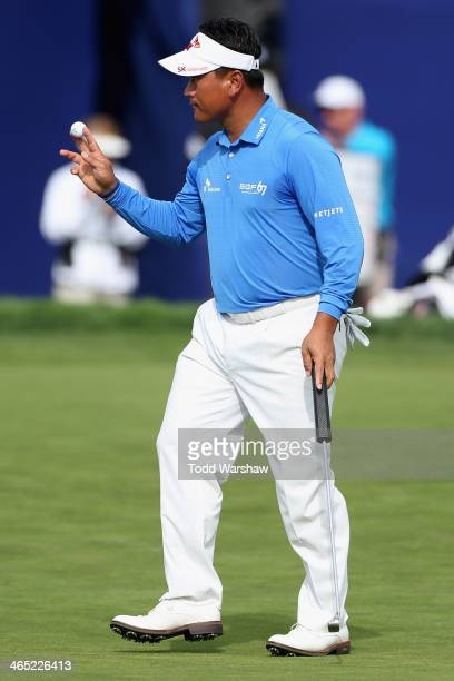 J Choi acknowledges the gallery after a birdie putt on the 18th hole during the final round of the Farmers Insurance Open on Torrey Pines South on...