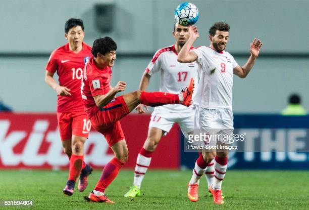 Choi Chulsoon of Korea Republic fights for the ball with Mahmoud Al Mawas of Syria during their 2018 FIFA World Cup Russia Final Qualification Round...
