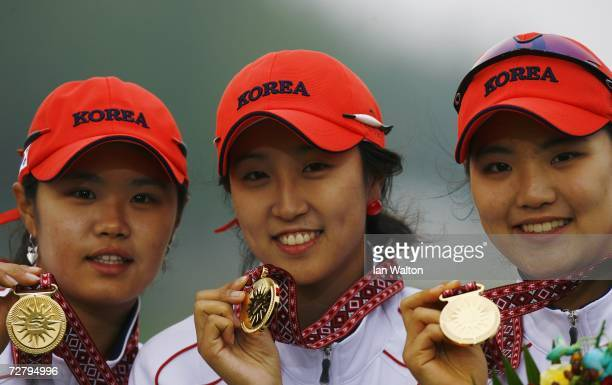 Choi He Yong Chung Jae Eun and Ryu So Yeon of the Republic of Korea receive their gold medals for winning the Women's Team Golf event after competing...