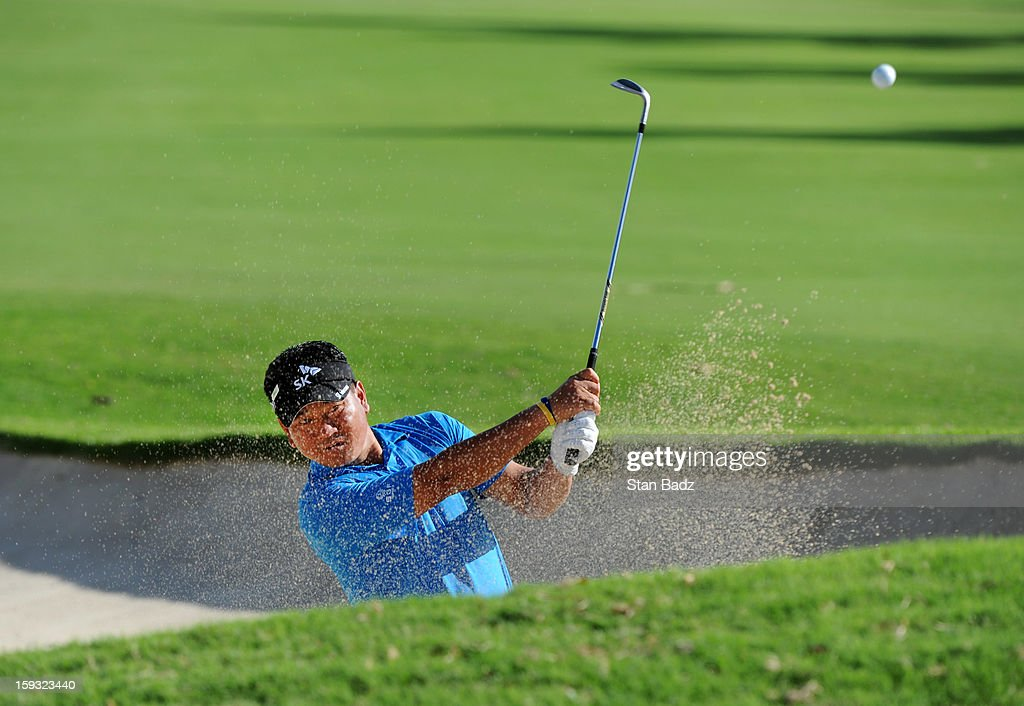 K.J. Choi hits from a bunker on the 18th hole during the second round of the Sony Open in Hawaii at Waialae Country Club on January 11, 2013 in Honolulu, Hawaii.