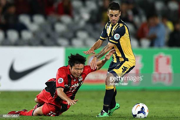 Choi Hyuntae of FC Seoul falls to the ground with Anthony Caceres of the Mariners in action during the AFC Asian Champions League match between the...