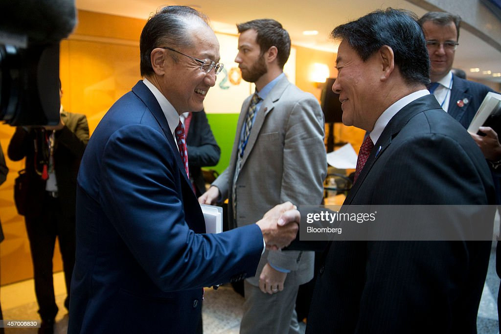 Choi Kyung Hwan, South Korea's finance minister, right, shakes hands with Jim Yong Kim, president of the World Bank Group, as they arrive to a Group of 20 (G-20) and finance ministers and central bank governors meeting on the sidelines of the International Monetary Fund (IMF) and World Bank Group Annual Meetings in Washington, D.C., U.S., on Friday, Oct. 10, 2014. As the IMF's annual meeting in Washington began, European Central Bank President Mario Draghi pledged anew to loosen monetary policy more if needed and called on those governments with the room to ease fiscal policy to do so. Photographer: Andrew Harrer/Bloomberg via Getty Images