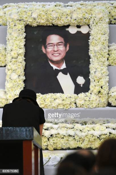 Choi KyungJin widow of late South Korean businessman Jee IckJoo who was allegedly killed by suspected policemen bows in front of a portrait of her...