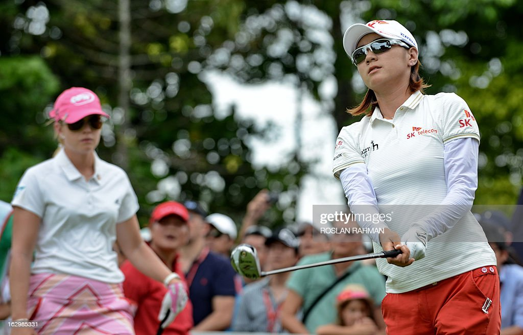 Choi Na Yeon of South Korea (R) hits a shot during the final round of the HSBC Women's Champions LPGA golf tournament at the Serapong Course in Singapore on March 3, 2013. The 1.4 million USD tournament takes place from February 28 to March 3.