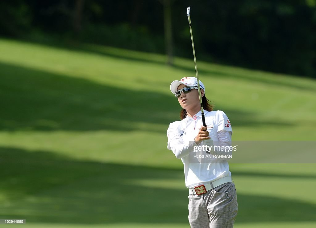 Choi Na Yeon of South Korea looks on after a shot along the fairway during round three of the HSBC Women's Champions LPGA golf tournament at the Serapong Course in Singapore on March 2, 2013. The 1.4 million USD tournament takes place from February 28 to March 3. AFP PHOTO / ROSLAN RAHMAN