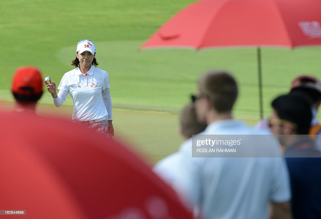 Choi Na Yeon of South Korea (L) reacts during round three of the HSBC Women's Champions LPGA golf tournament at the Serapong Course in Singapore on March 2, 2013. The 1.4 million USD tournament takes place from February 28 to March 3.