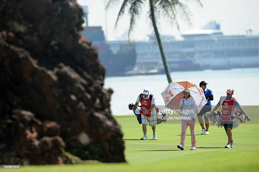 Choi Na Yeon (front) of South Korea walks to the 6th green during round two of the HSBC Women's Champions LPGA golf tournament at the Serapong Course in Singapore on March 1, 2013. The 1.4 million USD tournament takes place from February 28 to March 3. AFP PHOTO / ROSLAN RAHMAN