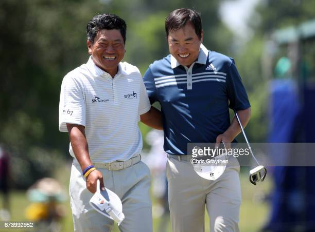 J Choi of Korea and Charlie Wi react after their putt on the ninth hole during the first round of the Zurich Classic at TPC Louisiana on April 27...