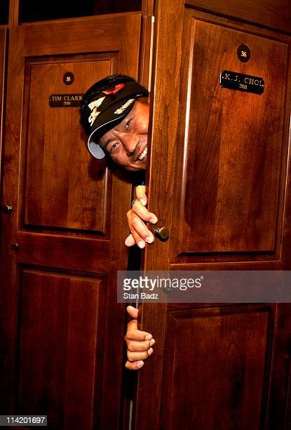 J Choi of Korea peers out from his new locker in the Champions locker room after the final round of THE PLAYERS Championship on THE PLAYERS Stadium...