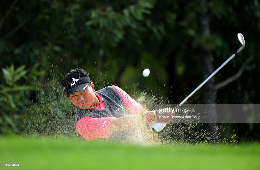 K J Choi of Korea plays a shot during round two of the CJ Invitational Hosted by KJ Choi, at Haesley Nine Bridges Golf Club on October 11, 2013 in Suwon, South Korea.