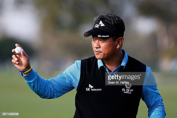 J Choi of Korea waves to the crowd on the 9th green during Round 2 of the Farmers Insurance Open at Torrey Pines North on January 29 2016 in San...