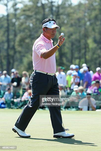 J Choi of Korea waves to the gallery during the first round of the 2014 Masters Tournament at Augusta National Golf Club on April 10 2014 in Augusta...