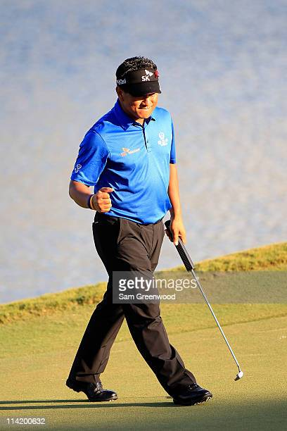 J Choi of South Korea celebrates making birdie on the 17th hole during the final round of THE PLAYERS Championship held at THE PLAYERS Stadium course...