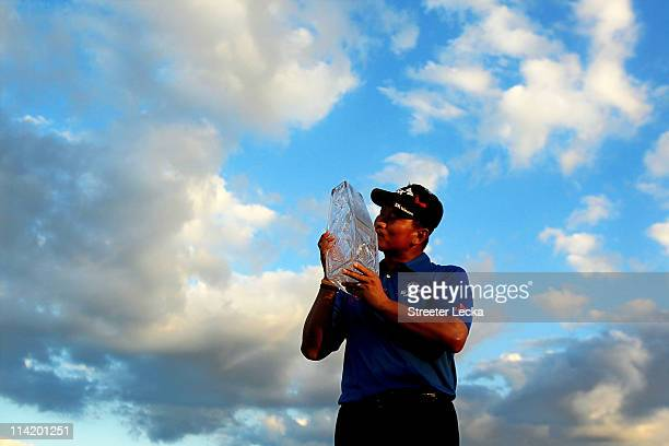 J Choi of South Korea celebrates with the trophy after defeating David Toms on the first playoff hole to win THE PLAYERS Championship held at THE...