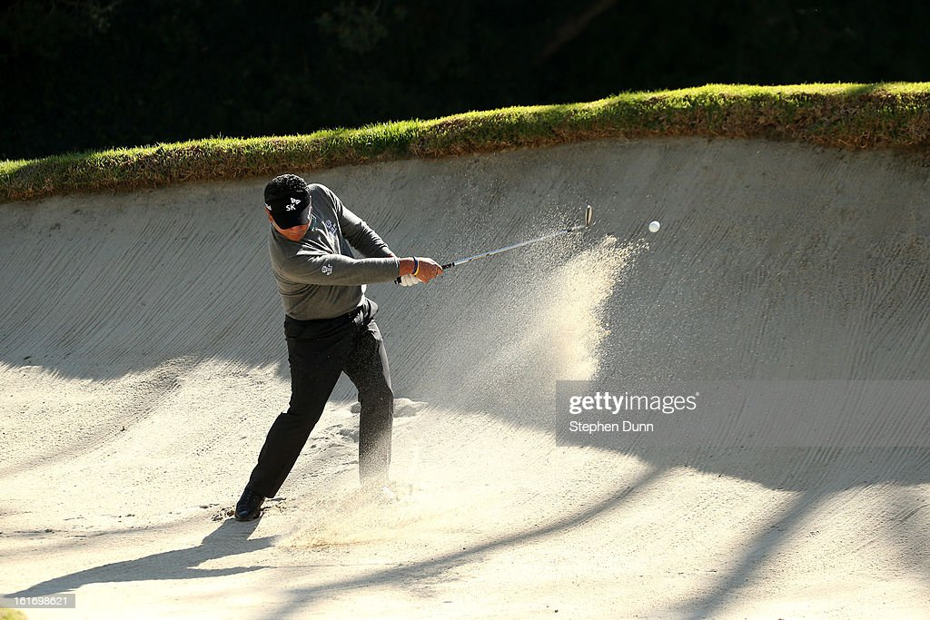 K.J. Choi of South Korea hits out of a bunker on the 12th hole during the first round of the Northern Trust Open at Riviera Country Club on February 14, 2013 in Pacific Palisades, California.
