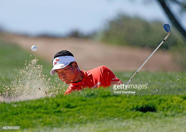 J Choi of South Korea plays a shot out of the bunker on the fourth hole during the third round of the Farmers Insurance Open at Torrey Pines South on...