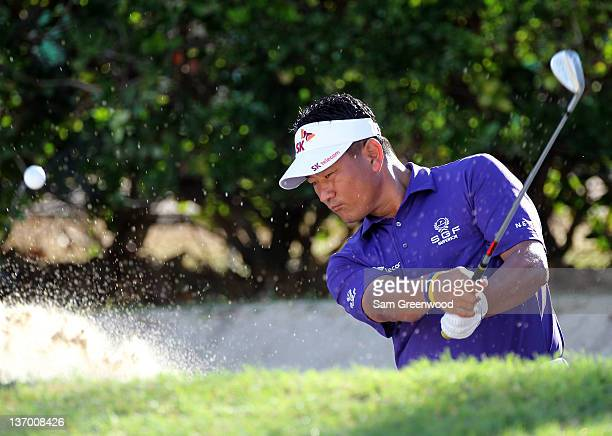 J Choi of South Korea plays a shot prior to the third round of the Sony Open in Hawaii at Waialae Country Club on January 14 2012 in Honolulu Hawaii